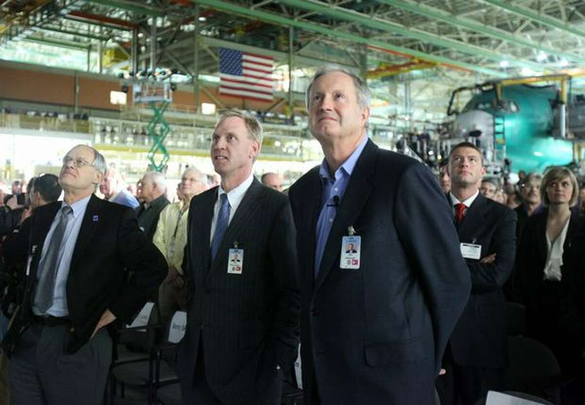 Boeing Commercial Airplanes President and Chief Executive Officer Jim Albaugh (right) watches a presentation during a ceremony celebrating the 1,000th Boeing 767 airplane and relocation of the 767 production line within Boeing's Everett plant.