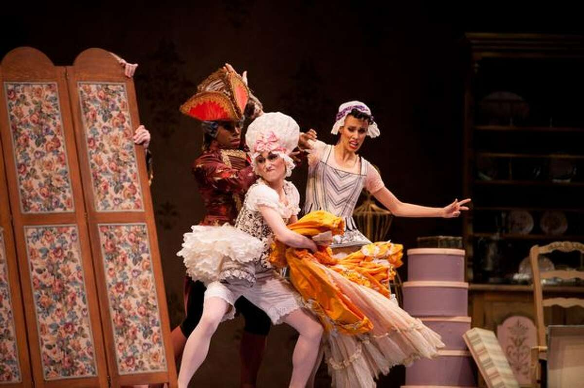 """The stepsisters fight over dresses in a comedic, rambunctious scene during Pacific Northwest Ballet's """"Cinderella."""""""