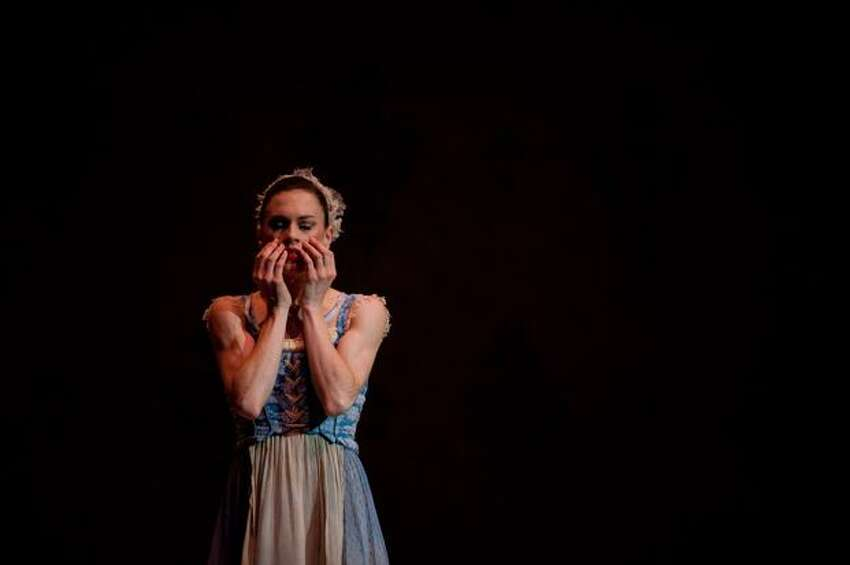 Rachel Foster, playing Cinderella, covers her face after the family leaves for the ball.