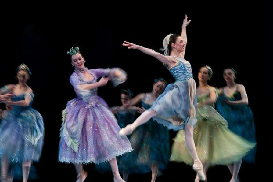 Cinderella leaps through the air after meeting her Fairy Godmother in the Pacific Northwest Ballet's