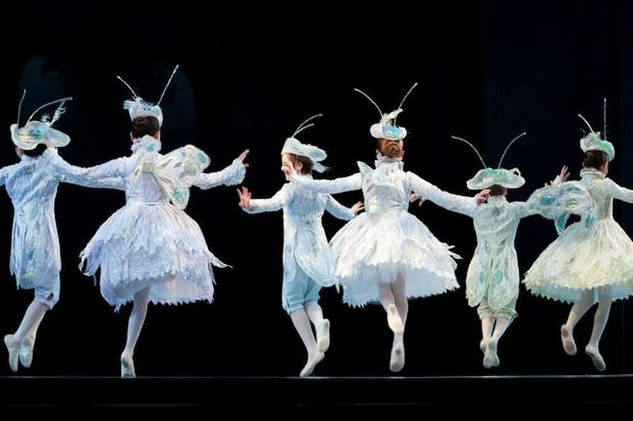 "Children play the roles of bugs in the Pacific Northwest Ballet's ""Cinderella."" Photo: Elliot Suhr, Seattlepi.com"