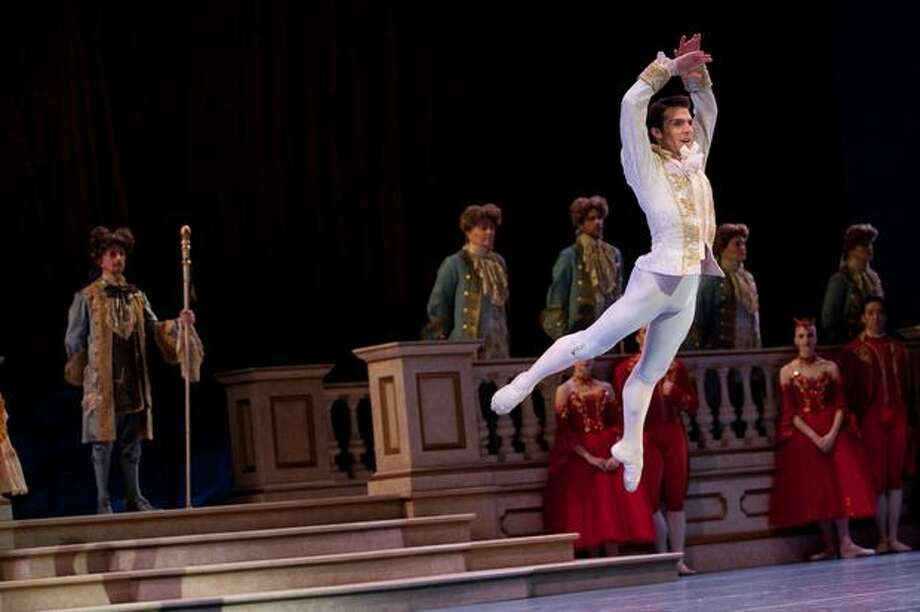 The prince, played by Lucien Postlewaite, leaps into the air upon Cinderella's arrival. Photo: Elliot Suhr, Seattlepi.com