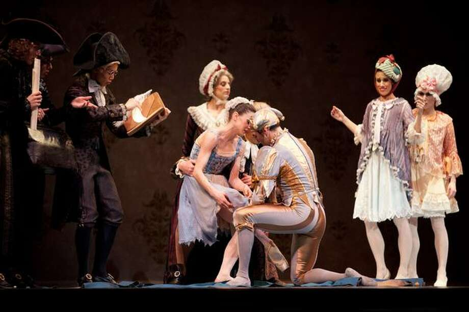 The jester slips the missing slipper onto Cinderella's foot. Photo: Elliot Suhr, Seattlepi.com