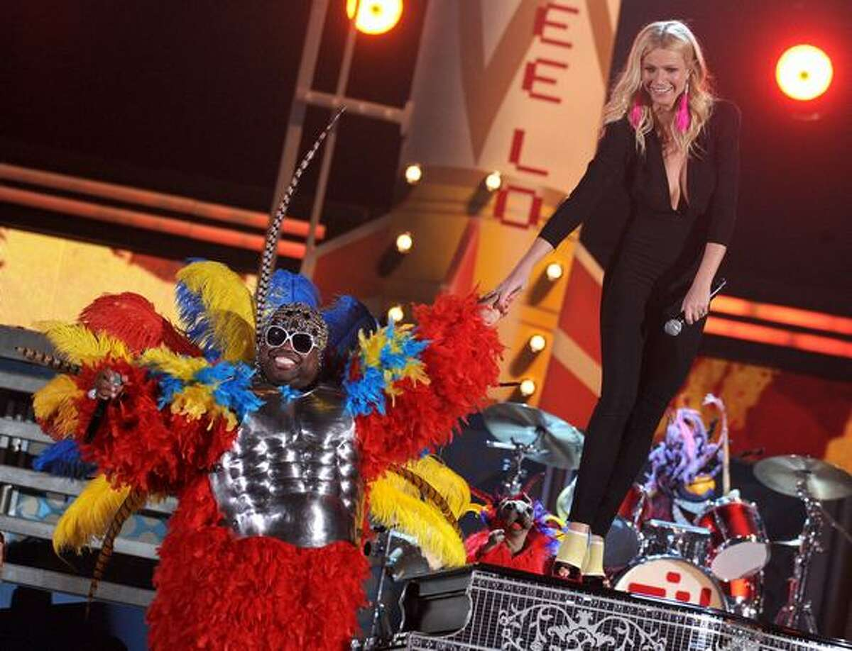 Singers Cee Lo Green (L) and Gwyneth Paltrow perform onstage during The 53rd Annual GRAMMY Awards held at Staples Center in Los Angeles, California.