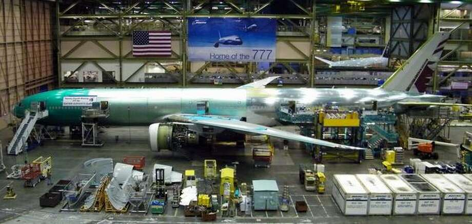 A Boeing 777 for Qatar Airways nears completion in Boeing's wide-body plant in Everett on Feb. 13, 2011. Boeing now produces 777s in a moving assembly line, as opposed to the fixed-position slant line shown in the earlier slide. Photo: Aubrey Cohen, Seattlepi.com