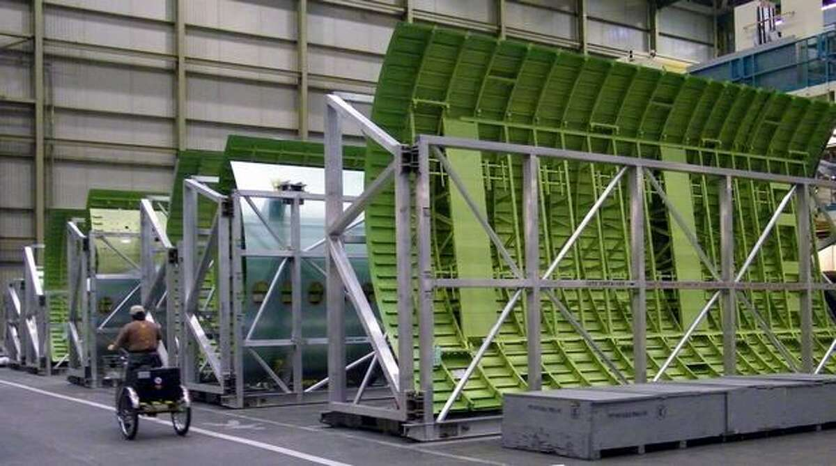 Fuselage panels for a Boeing 777 acclimate in Boeing's wide-body plant in Everett, Wash.