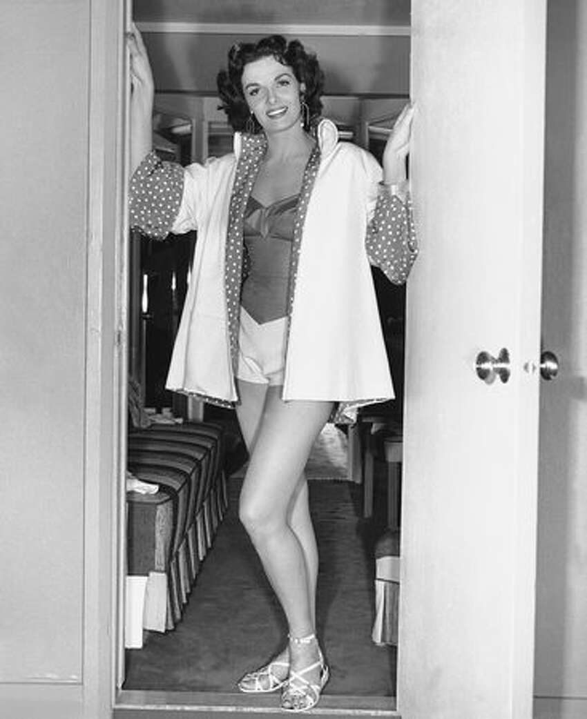 In this Dec. 26, 1952 file photo, actress Jane Russell poses for photos on the set of