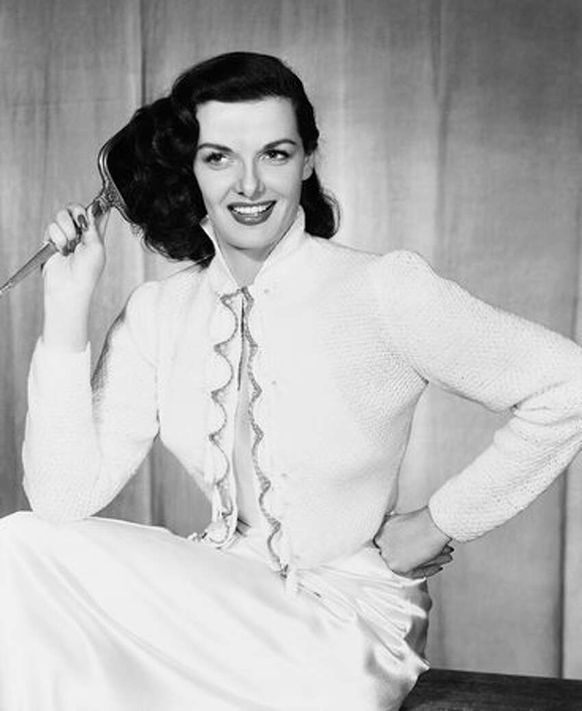 In this May 31, 1952 file photo, actress Jane Russell models a bedjacket. A family member on Monday, Feb. 28, 2011 said Russell, stunning star of 1940s and 1950s films, has died at age 89.