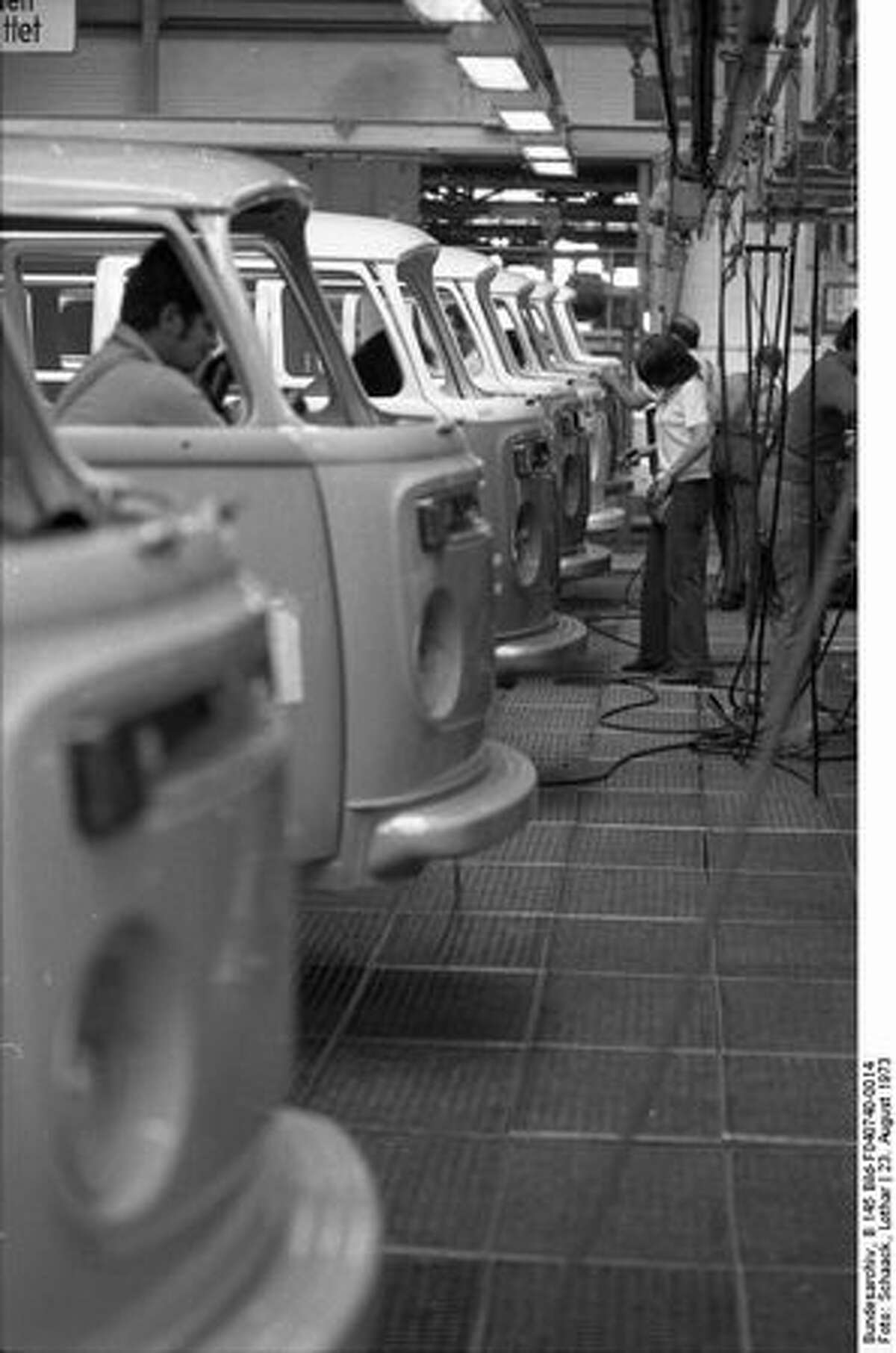 In this Aug. 23, 1973, photo, workers on the assembly line build Volkswagen Type 2 vans at VW Autowerks in Hannover, Germany. (Wikimedia Commons photo)