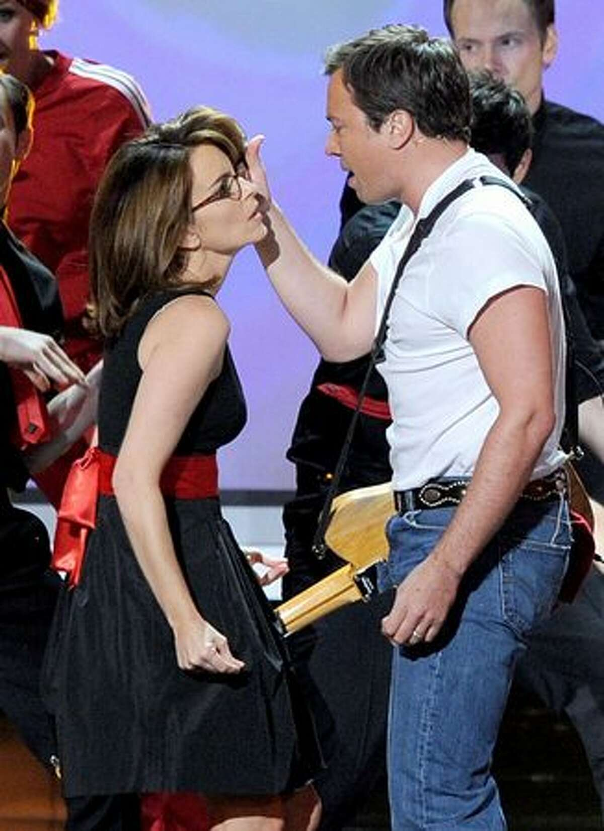 Actress Tina Fey (L) and host Jimmy Fallon perform onstage.