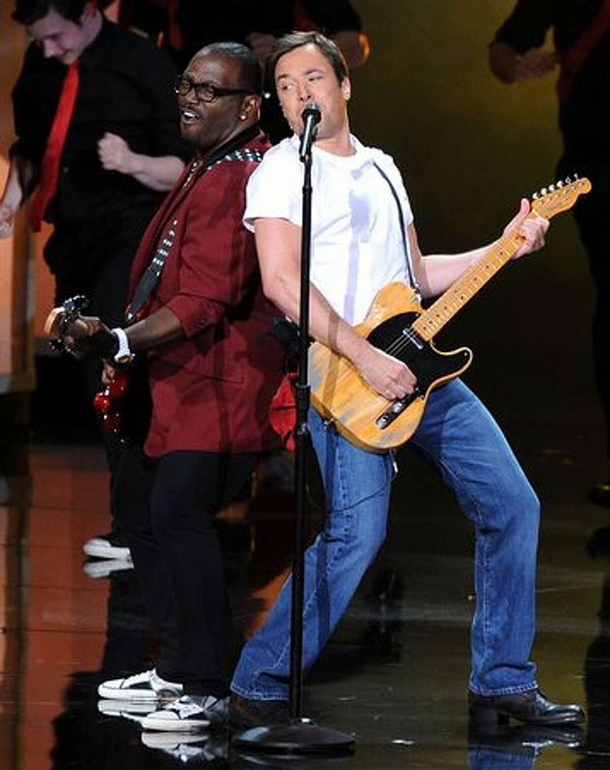 Musician Randy Jackson (L) and host Jimmy Fallon perform onstage.