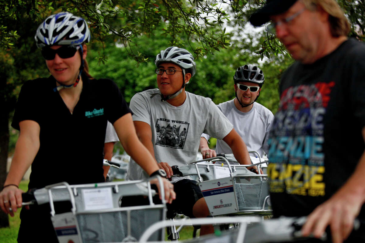 Jenny Willhite (from left), Dewey Maneewat, Blake Sammons and Tom McKenzie get ready to ride B-cycles from the San Antonio B-cycle HUB to the B-cycle stations around downtown San Antonio on Saturday.