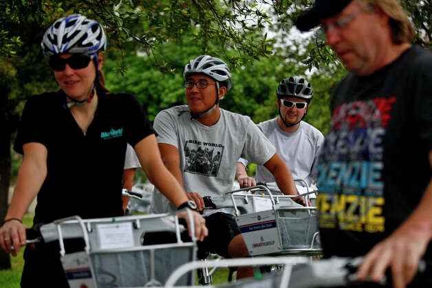 Jenny Willhite (from left), Dewey Maneewat, Blake Sammons and Tom McKenzie get ready to ride B-cycles from the San Antonio B-cycle HUB to the B-cycle stations around downtown San Antonio on Saturday. Photo: LISA KRANTZ/lkrantz@express-news.net / SAN ANTONIO EXPRESS-NEWS