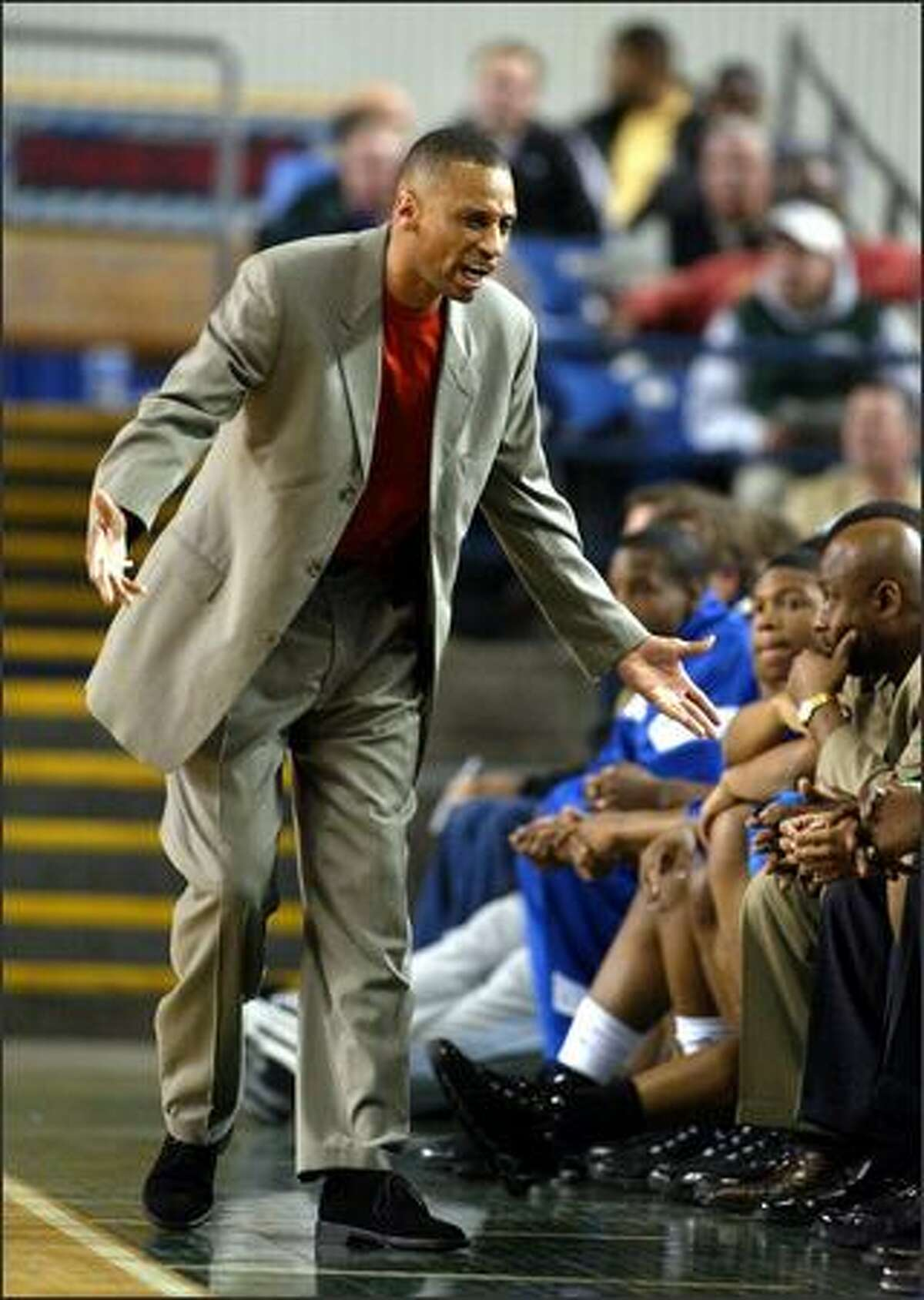 The mood on the Rainier Beach bench was not pleasant in the early going of their first round game against Mount Rainier, as exhibited here by head coach Mike Bethea. Mount Rainier ran out to an early lead but couldn't hold it in the end.