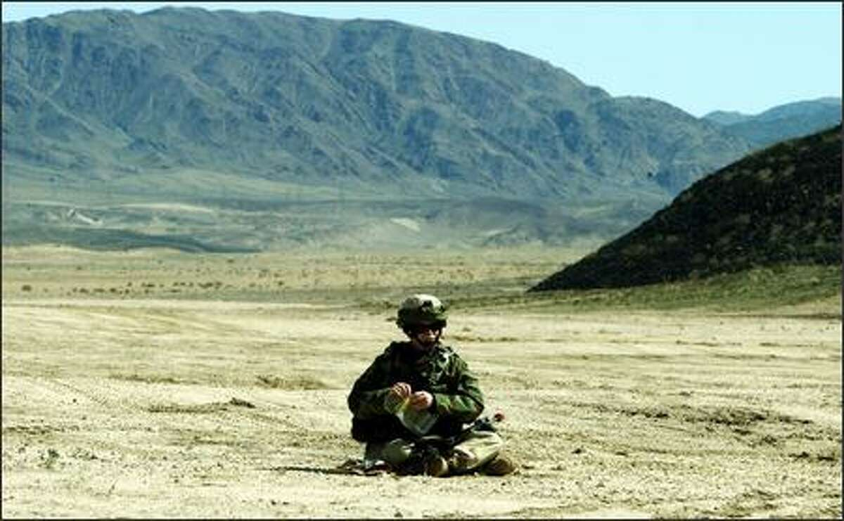 Sgt. Kenneth Keith 53, of Olympia, takes a lunch break during a training session in California's Mojave Desert.