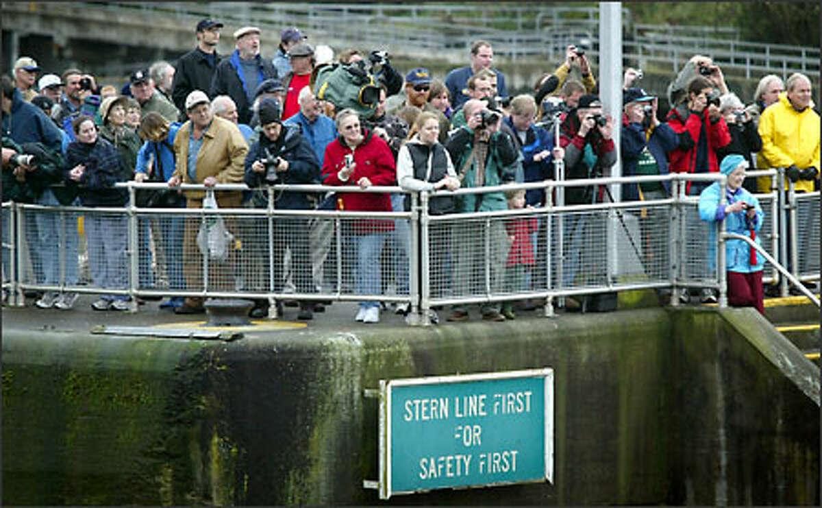 A waiting crowd greets the Kalakala at the Ballard Locks as it makes its way toward Puget Sound.