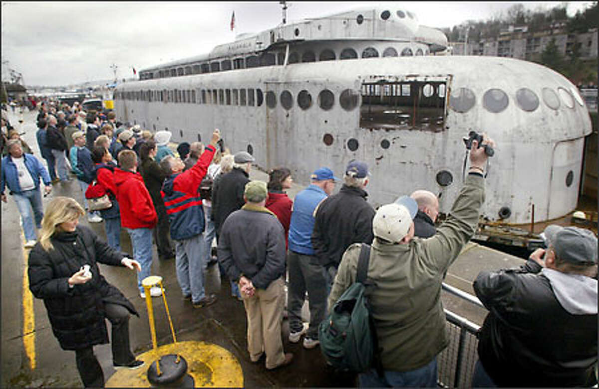 Hundreds of watchers turn out at the Ballard Locks to watch the vintage ferry pass through on it way to Neah Bay.