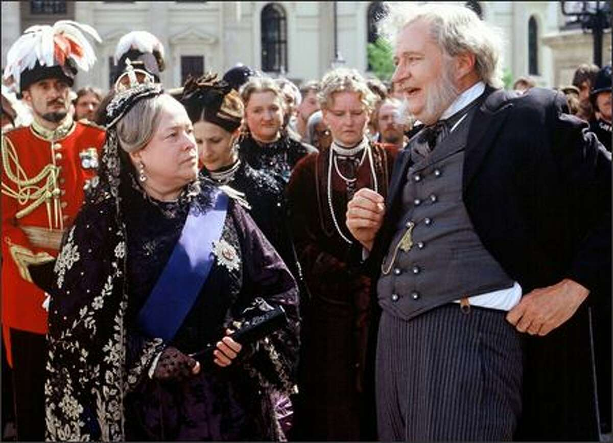 Queen Victoria (Kathy Bates, left) has some harsh words for Lord Kelvin (Jim Broadbent, right).