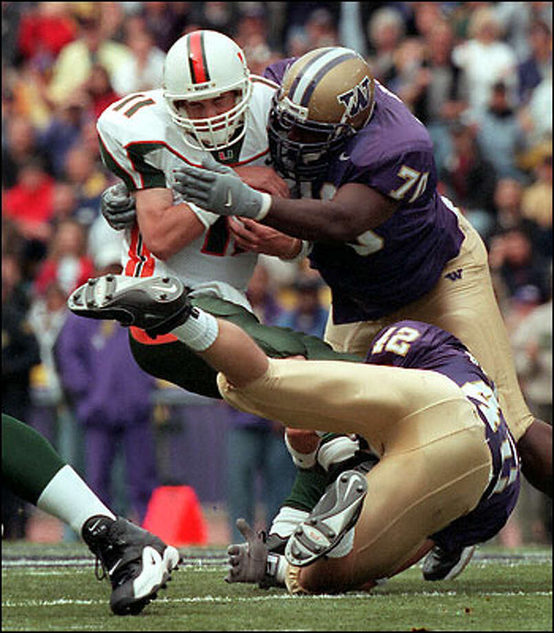 The Huskies' Larry Tripplett (70) gets the sack on Miami QB Ken Dorsey (11) Photo: Grant M. Haller, Seattle Post-Intelligencer