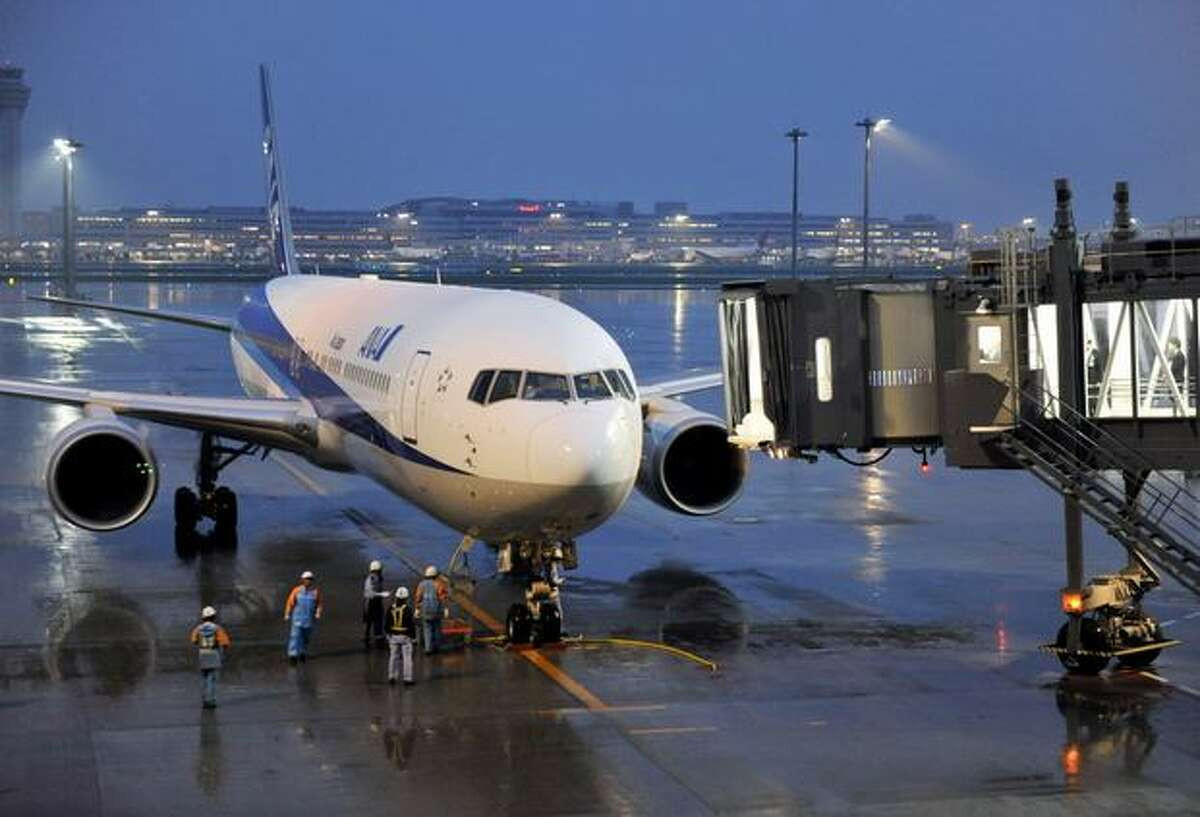 The first flight for the newly opened terminal, an All Nippon Airways flight from Hong Kong arrives at Tokyo International Airport.