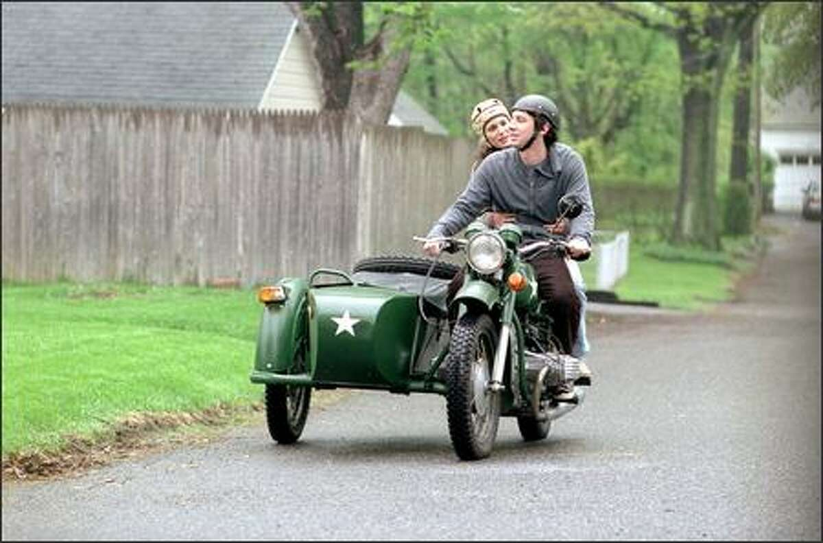 Natalie Portman (rear) plays the sidekick who refuses to ride in Zach Braff's sidecar.