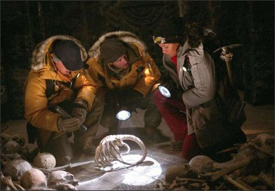 Miller (Ewen Bremner), Sebastian (Raoul Bova) and Lex (Sanaa Lathan) make a shocking discovery deep under the Antarctic ice: an Alien face hugger. Photo: Fox