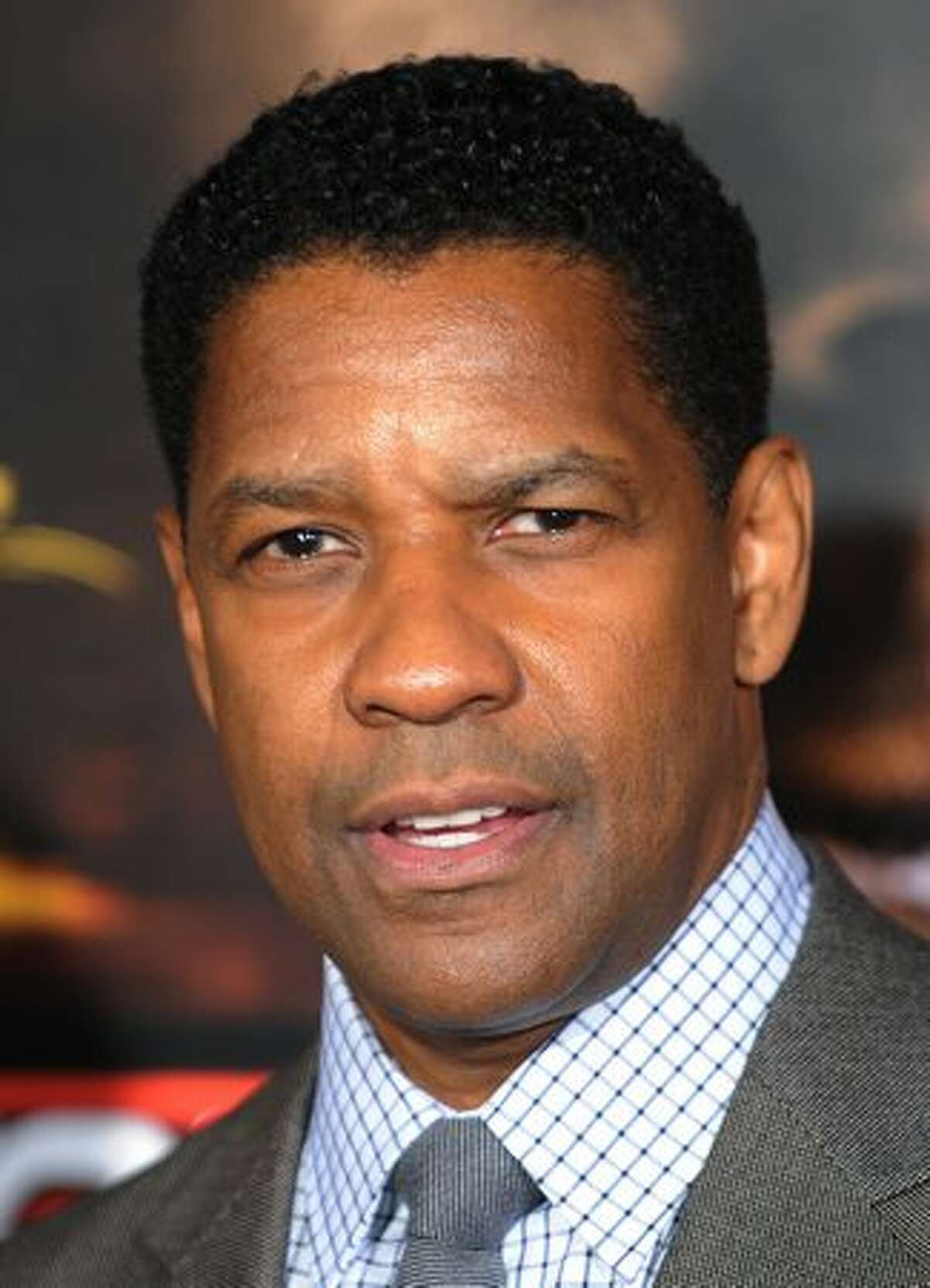 Actor Denzel Washington arrives on the red carpet for the premiere of the film