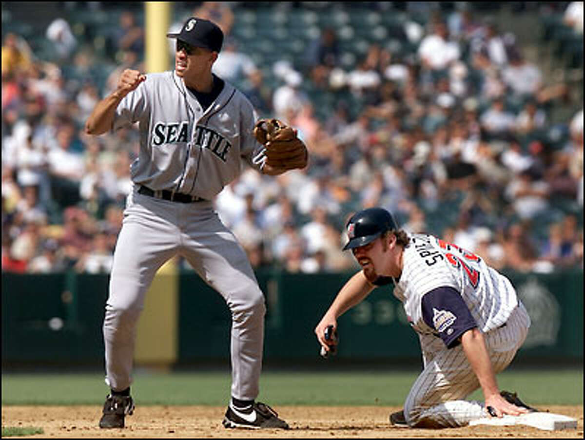 Alex Rodriguez turns the double play, nailing Scott Spiezio at second in the Anaheim 3rd.
