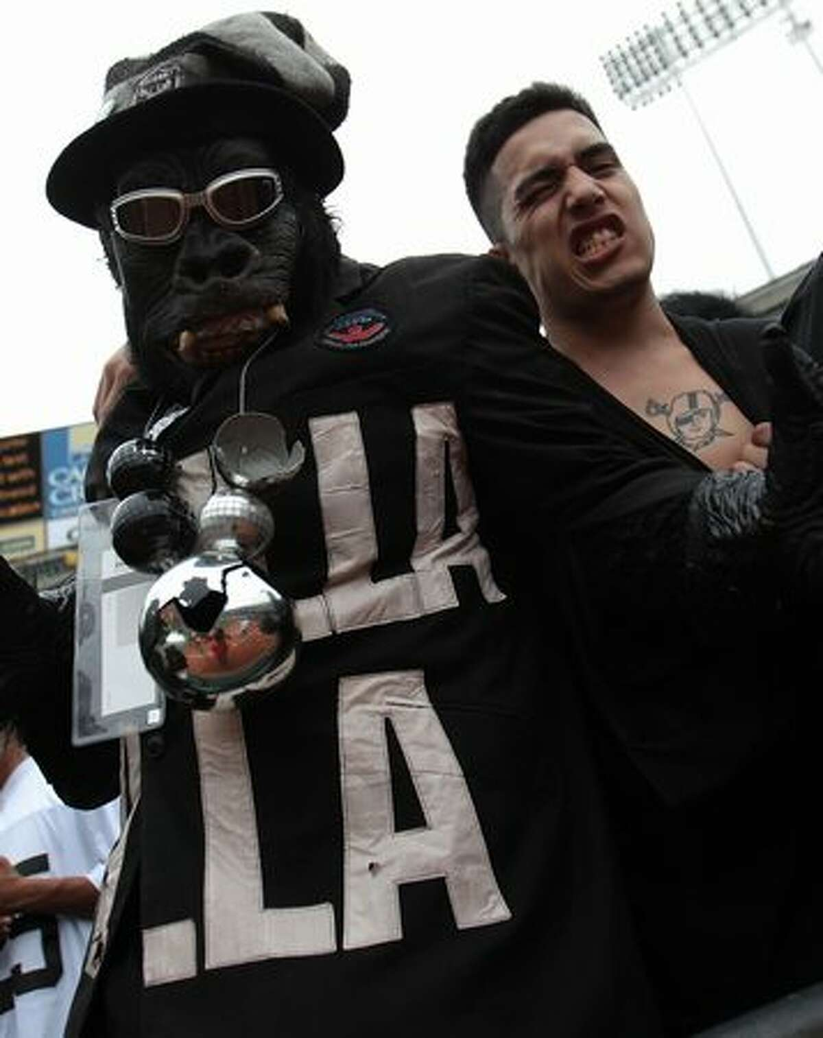 Fans of the Oakland Raiders cheer against the St. Louis Rams during an NFL game at Oakland-Alameda County Coliseum on September 19, 2010 in Oakland, California.