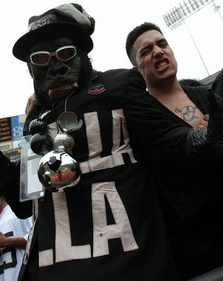 Fans of the Oakland Raiders cheer against the St. Louis Rams during an NFL game at Oakland-Alameda County Coliseum on September 19, 2010 in Oakland, California. Photo: Getty Images