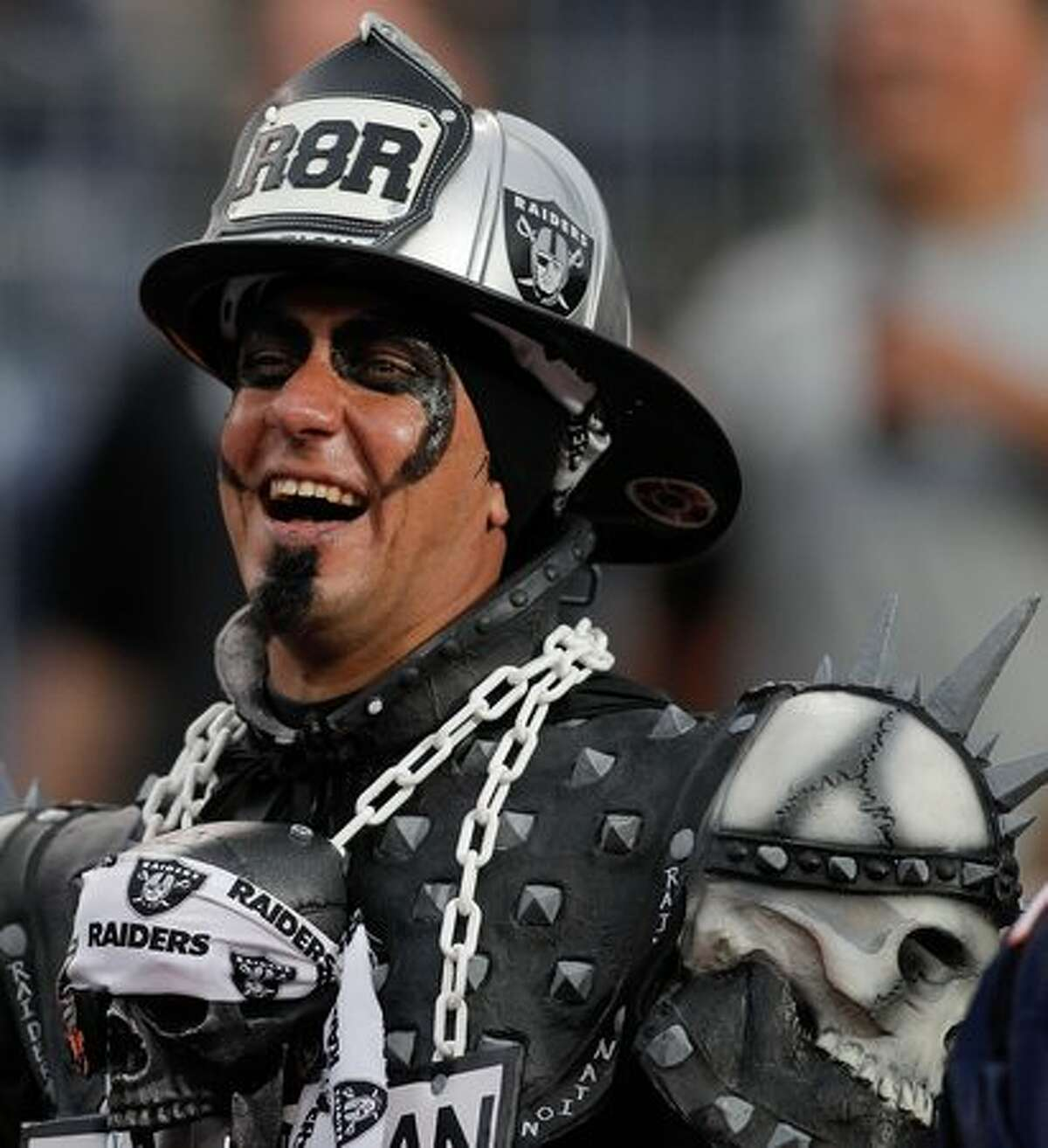 An Oakland Raiders fan is all smiles during the Raiders 59-14 victory over the Denver Broncos at INVESCO Field at Mile High on October 24, 2010 in Denver, Colorado.