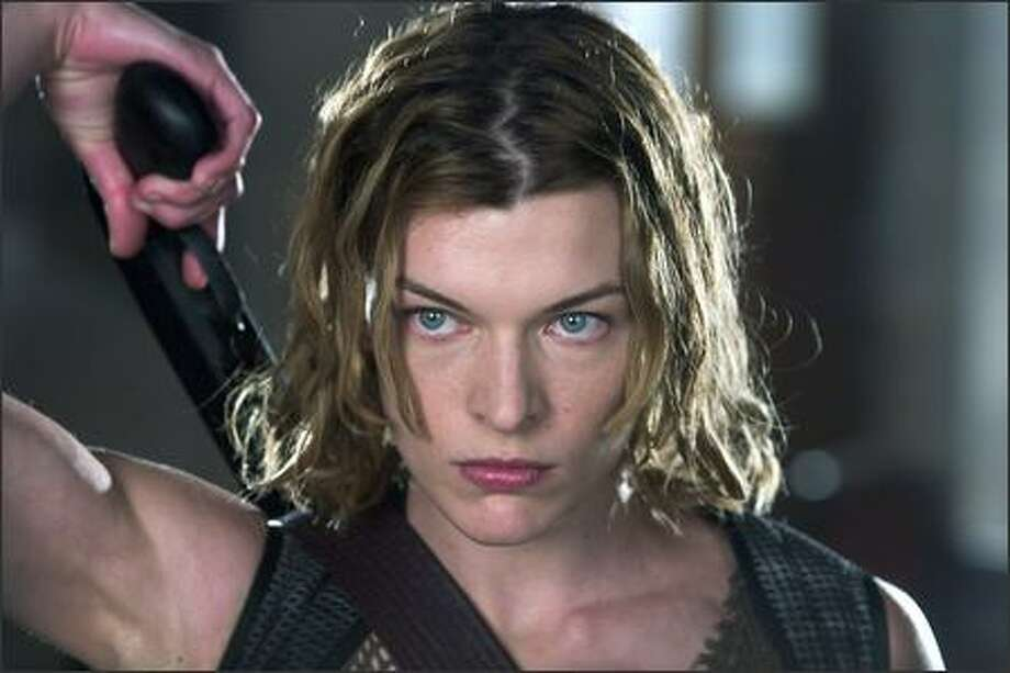 "Multi-talented Milla Jovovich reprises her role as Alice in ""Resident Evil: Apocalypse,"" rated R for non-stop violence, language and some nudity. The movie runs 94 minutes. Photo: Rolf Konow, © 2004 Davis Films/Impact (Canada) Inc./Constantin Film (UK)Limited"
