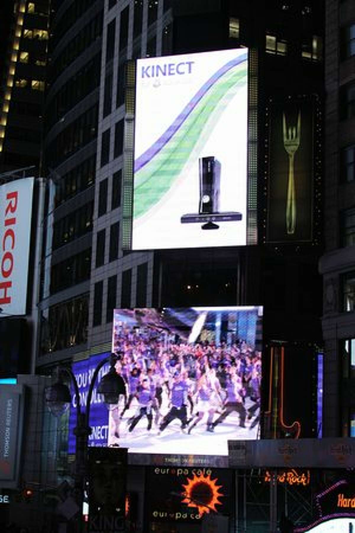 Microsoft took over Times Square on Wednesday, draping it in purple and hosting a dance party with thousands to celebrate the launch of its newest product, Kinect for Xbox 360.