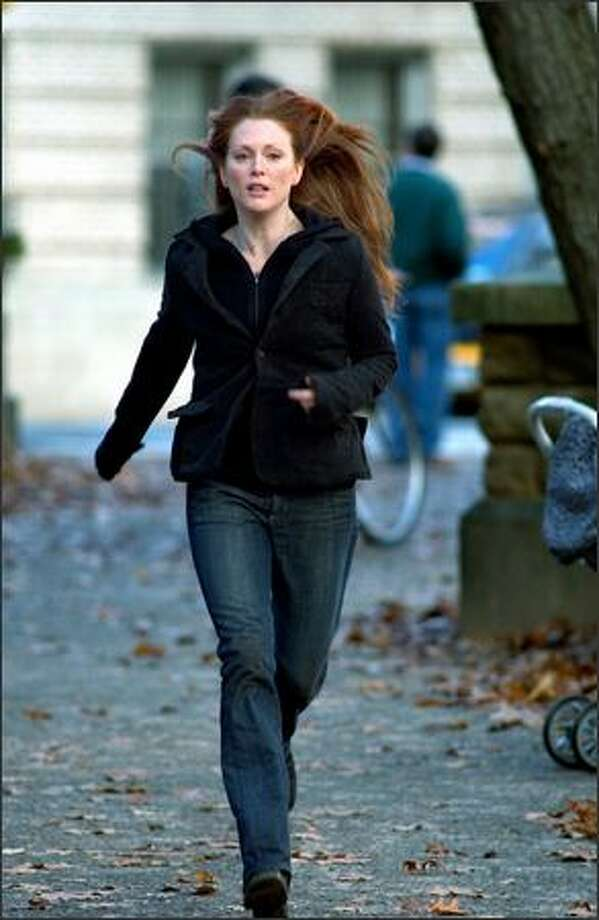 """Julianne Moore stars in """"The Forgotten"""" as a grieving mother who is told that she is suffering from delusions, that her son never existed and she is fabricating his memories. Stunned, she tries to find evidence of his existence — but it has all disappeared. Photo: Columbia Pictures"""