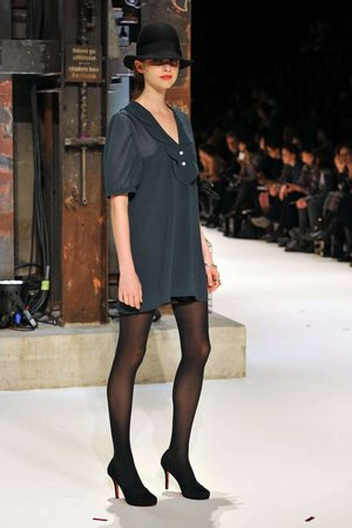 A model walks the catwalk during the second day of the Charles Vogele Fashion Days in Zurich, Switzerland.