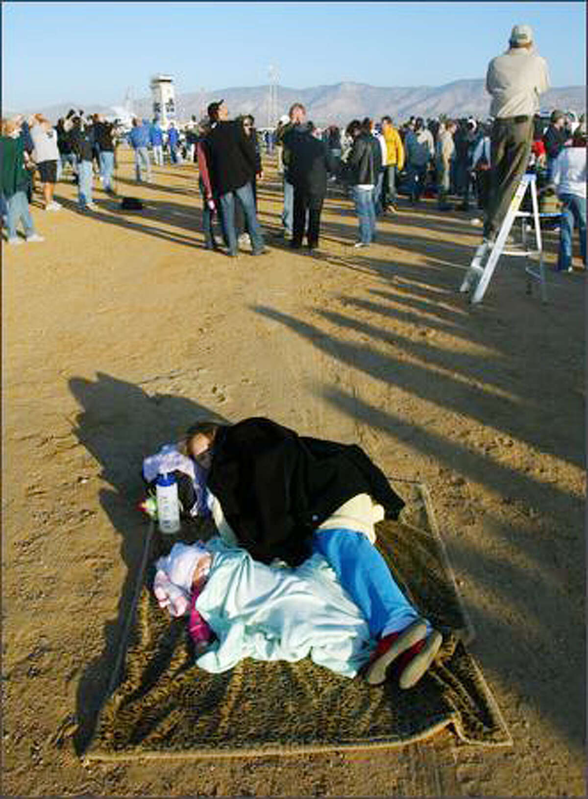 Ryannn Ortiz, 7 months old, and her aunt Stephanie Gomez, 21, decided that a little shut eye was more important than watching for SpaceShipOne to return. Some folks arrived at 3 a.m. for the 7:15 a.m. takeoff.