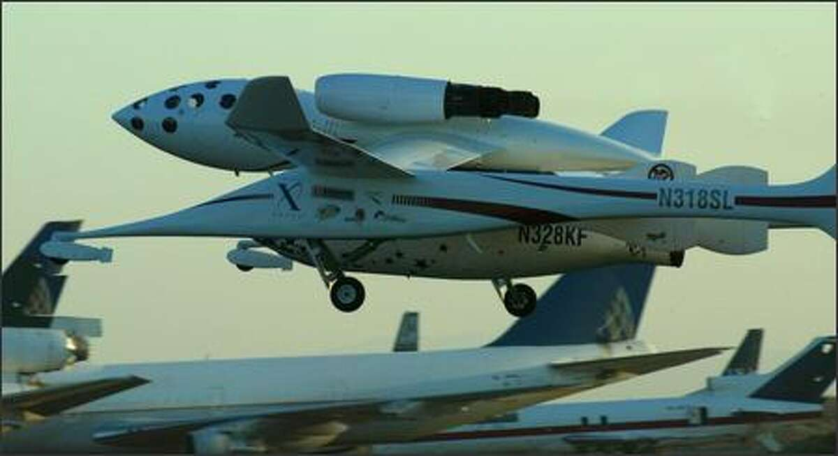 White Knight and SpaceShipOne leave the airport.