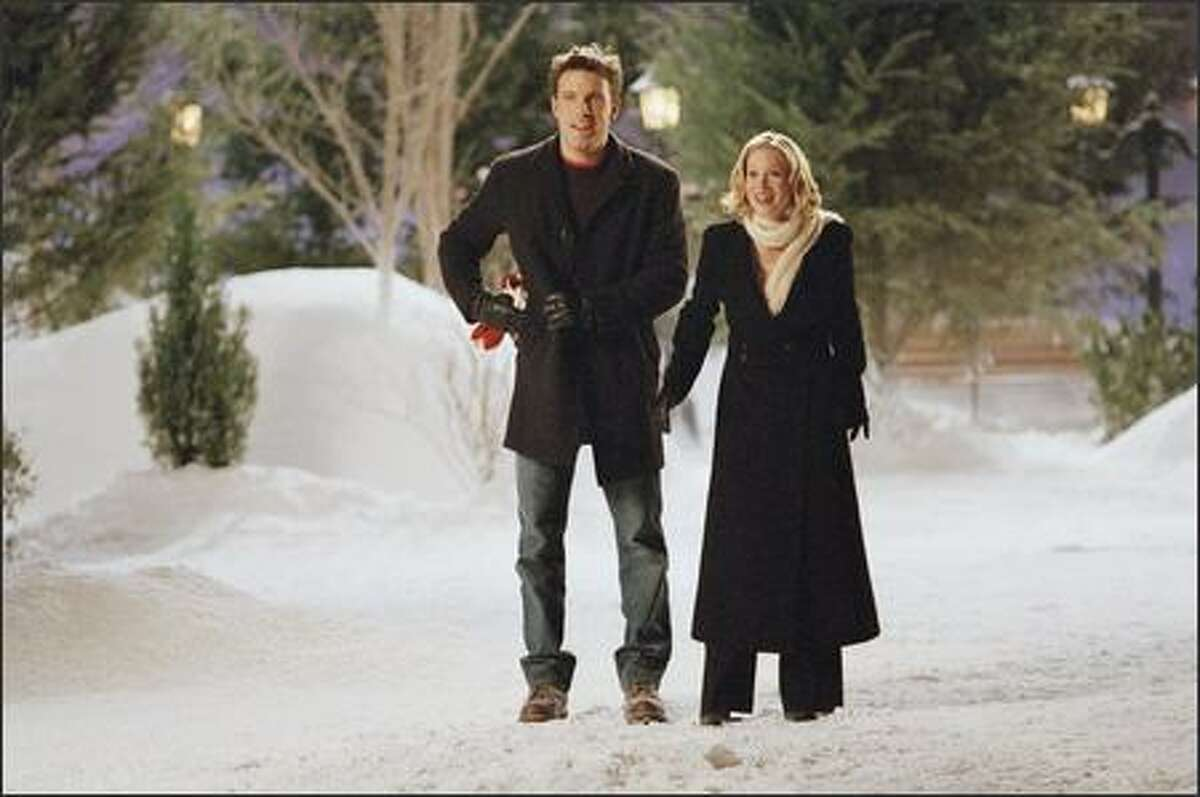 Drew Latham (Ben Affleck) surprises Alicia Valco (Christina Applegate) with his own version of the spirit of Christmas past