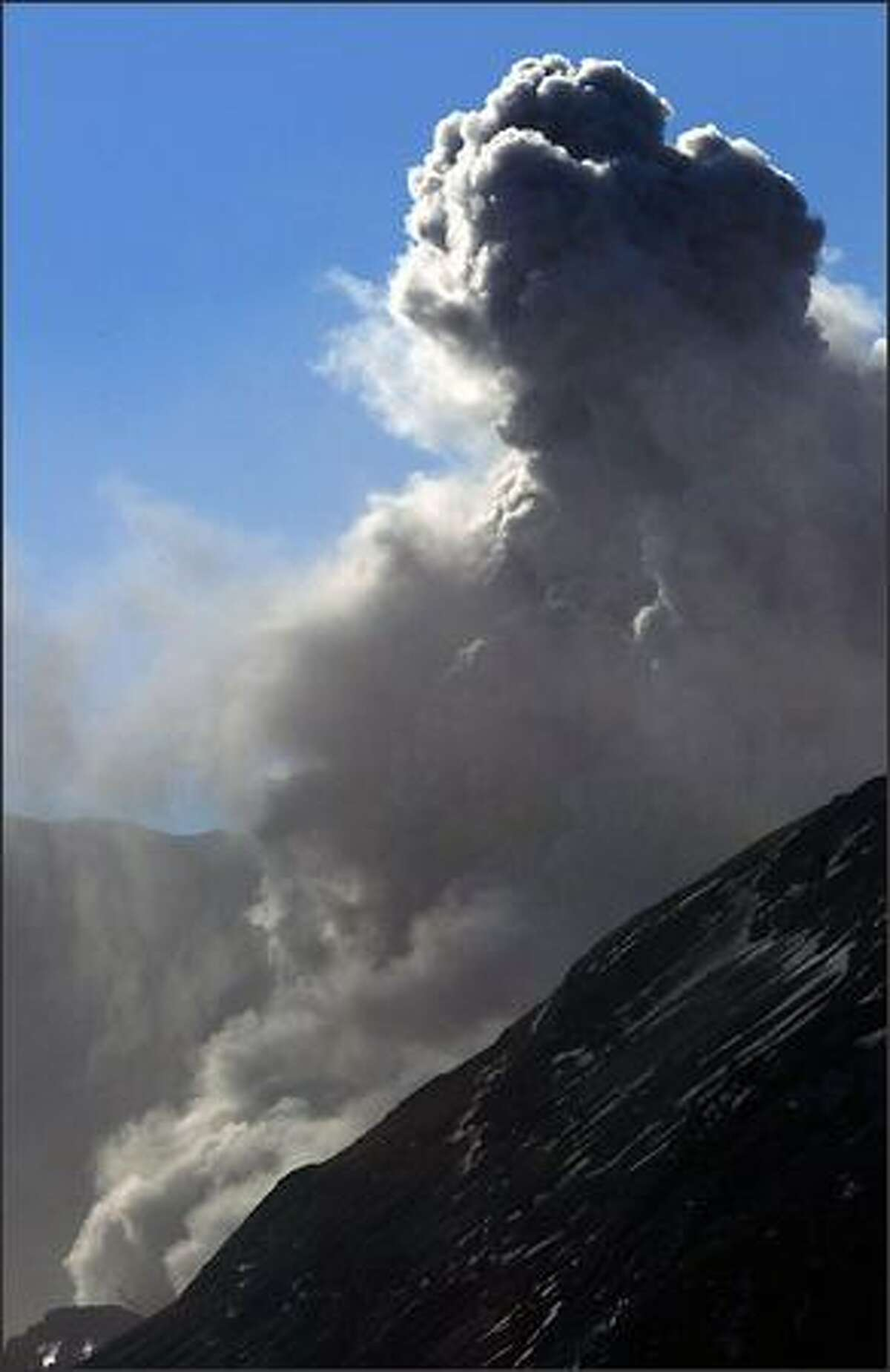 Mount St. Helens erupts at approximately 9:40 a.m. Monday as seen from the Coldwater Ridge Visitor Center.