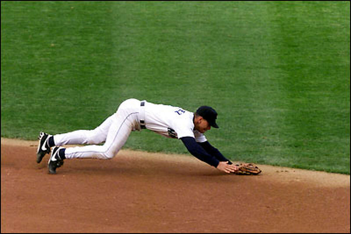 Alex Rodriguez dives to start a stellar defensive play behind second base.