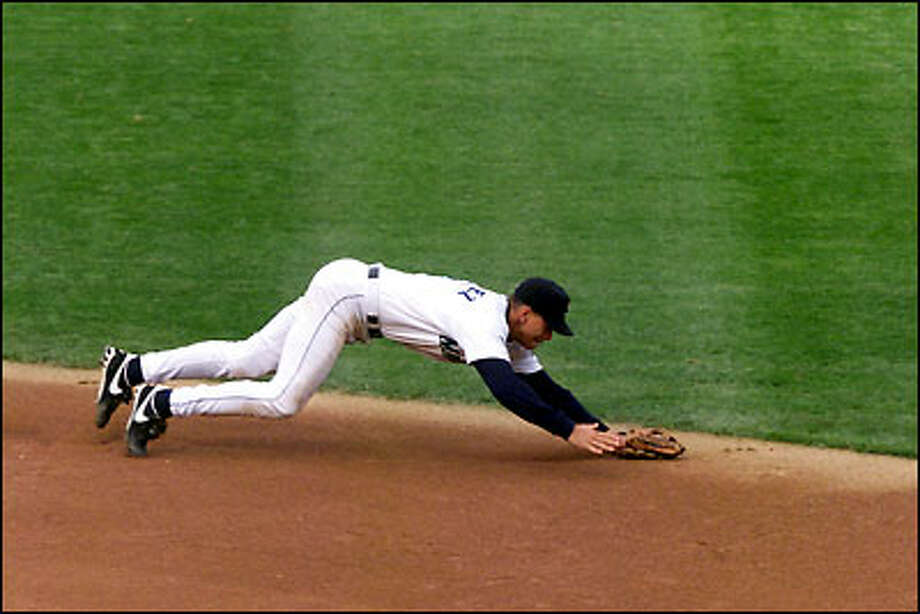 Alex Rodriguez dives to start a stellar defensive play behind second base. Photo: Grant M. Haller, Seattle Post-Intelligencer