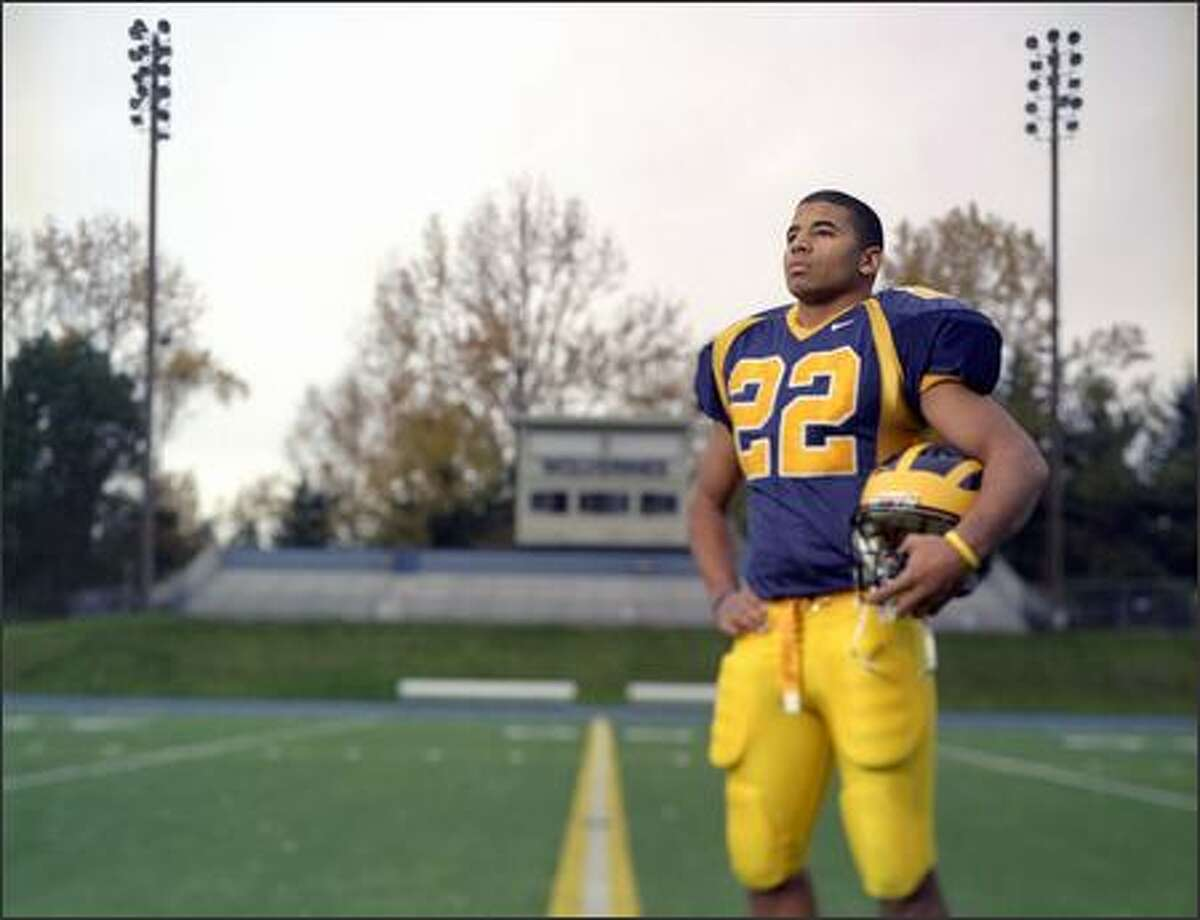 Football (defense) most valuable athlete E.J. Savannah of Bellevue, perhaps the most talented linebacker to ever wear the blue and gold of that school. This season, the 6-2, 215-pound linebacker recorded 72 solo tackles and nine tackles for losses, including four and a half sacks.