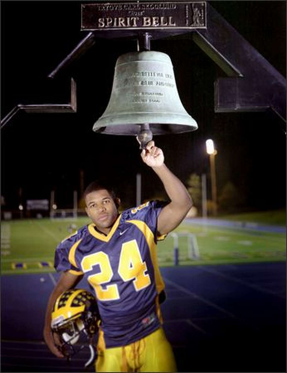 Football (offense) most valuable athlete J.R. Hasty of Bellevue, photographed at Bellevue High School with the school's Spirit Bell. 5,493. The 5-foot-10, 200-pound senior running back had the fifth-best single-season yardage total in state history with 2,519 and a state-record 50 touchdowns, 19 on plays of more than 25 yards.