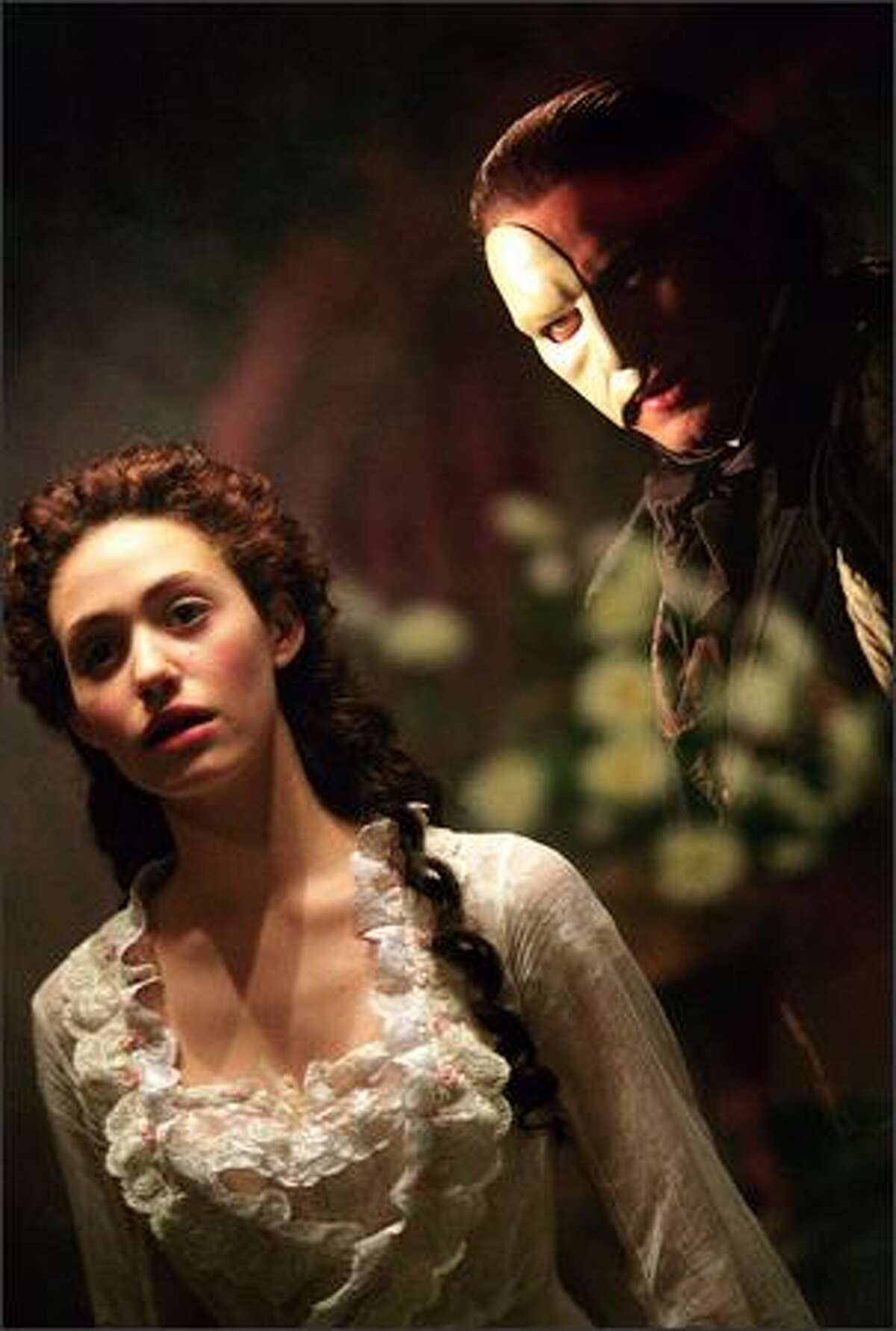 Christine (Emmy Rossum) and her mysterious