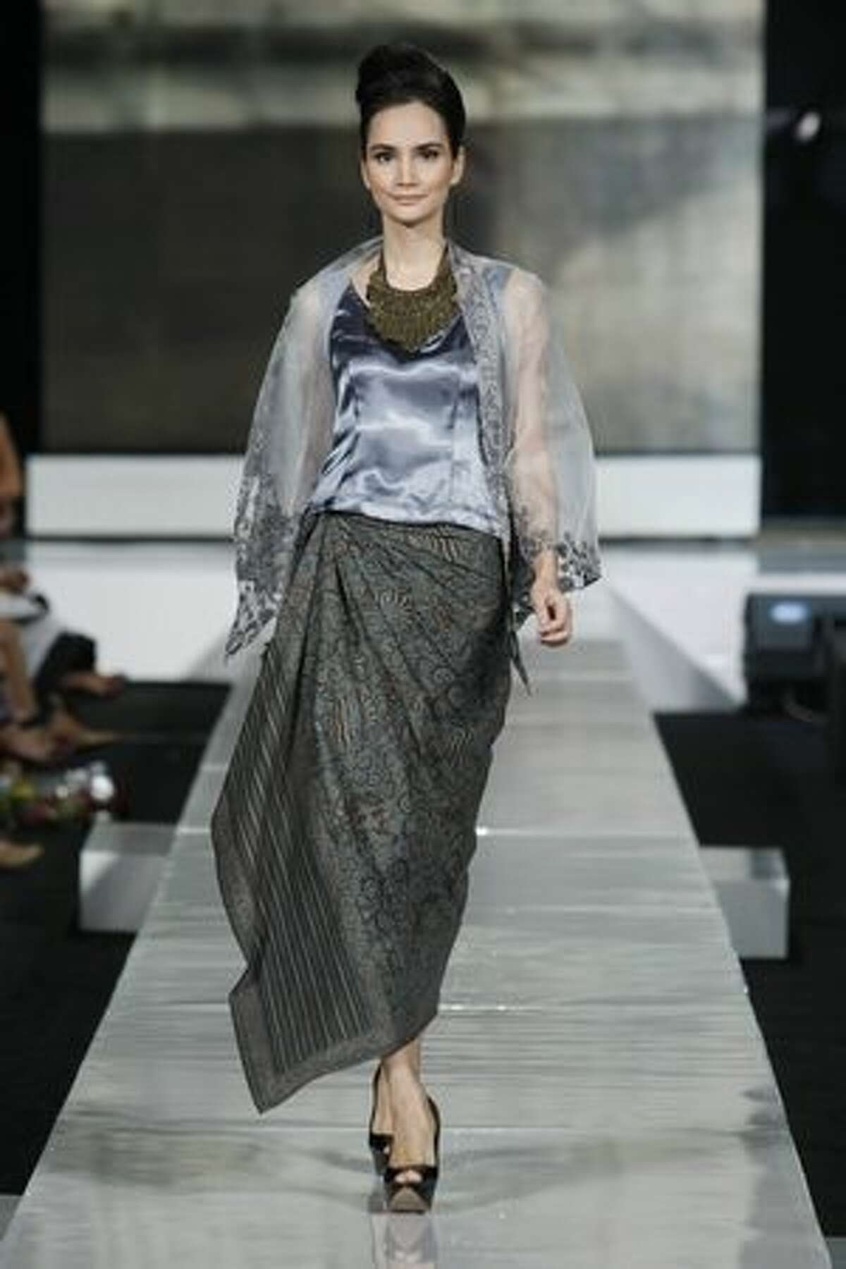 A model showcases designs on the runway by Inez Mardiana during the DEKRANASDA show on the second day of Jakarta Fashion Week 2010 in Jakarta, Indonesia.