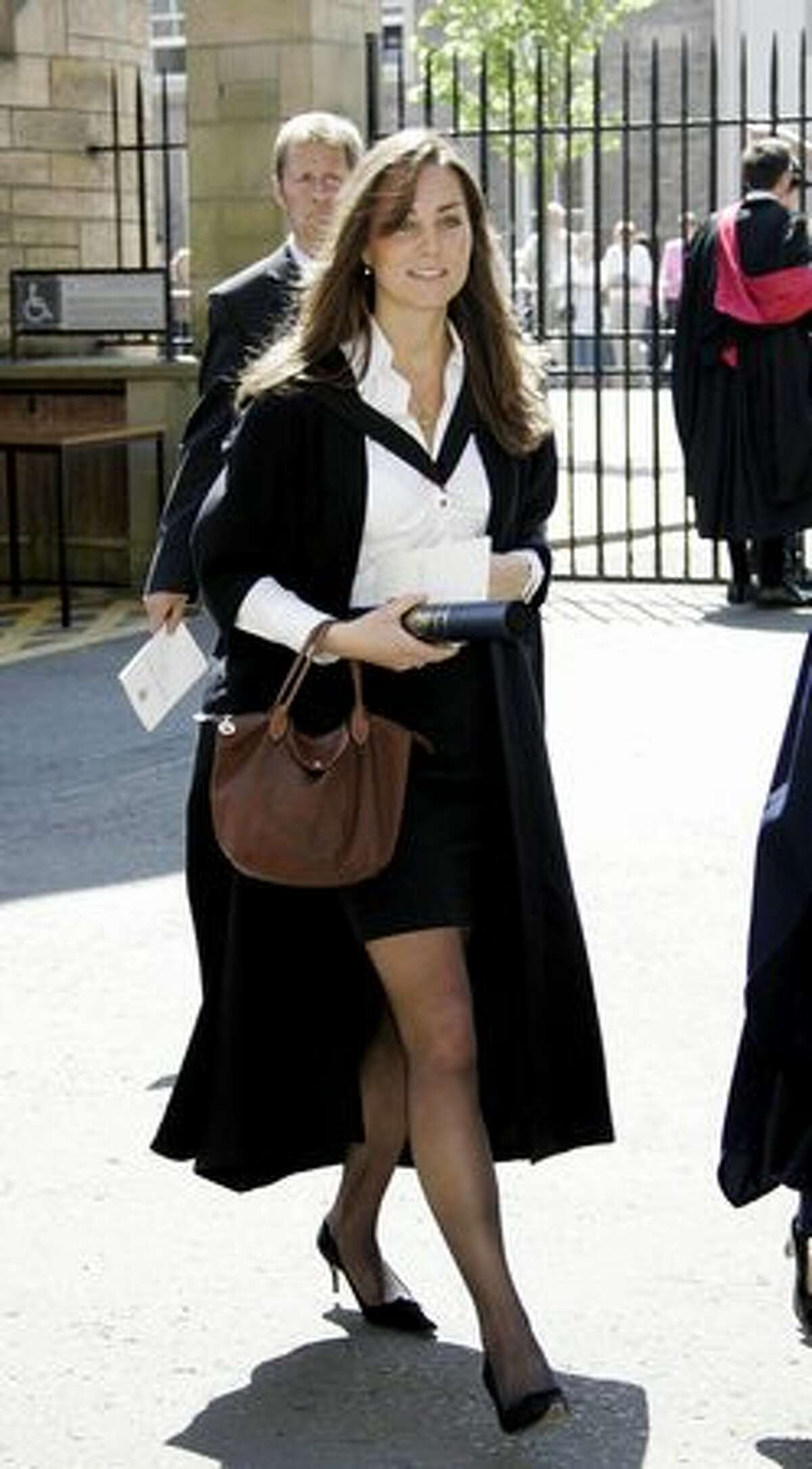 Kate Middleton walks during her graduation ceremony at St. Andrews, Scotland, June 23, 2005.