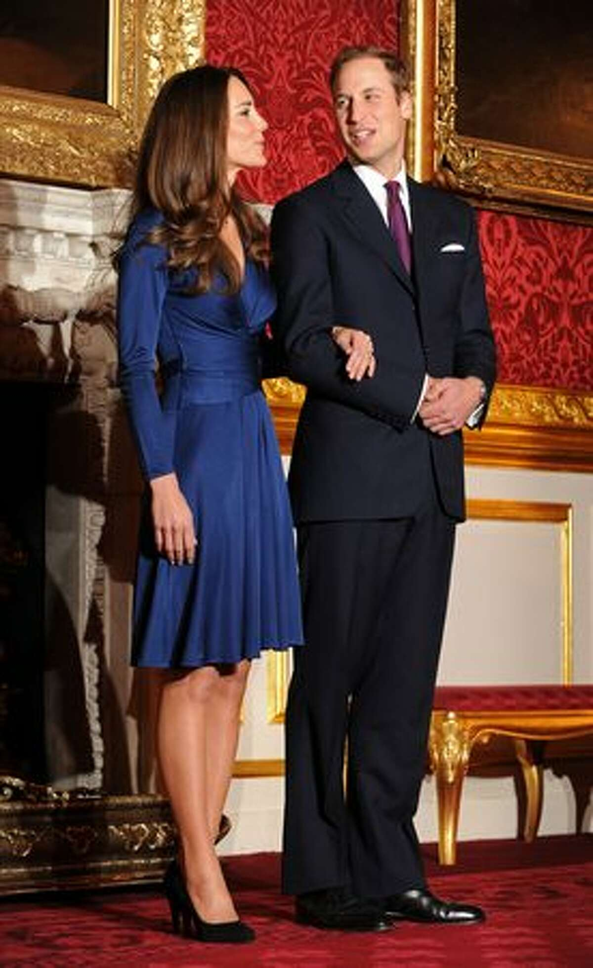 Britain's Prince William and his fiancée Kate Middleton pose for photographers during a photocall to mark their engagement.