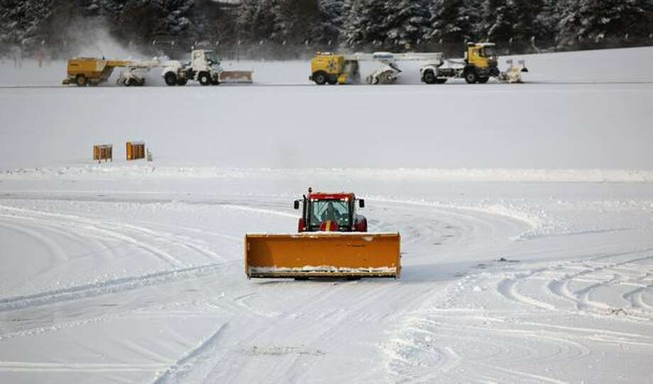Crews attempt to clear snow from one of the runways at Edinburgh Airport, in Edinburgh, Scotland. Freezing weather conditions and heavy snow have forced Scotland's main airport to close for the day. Photo: Getty Images