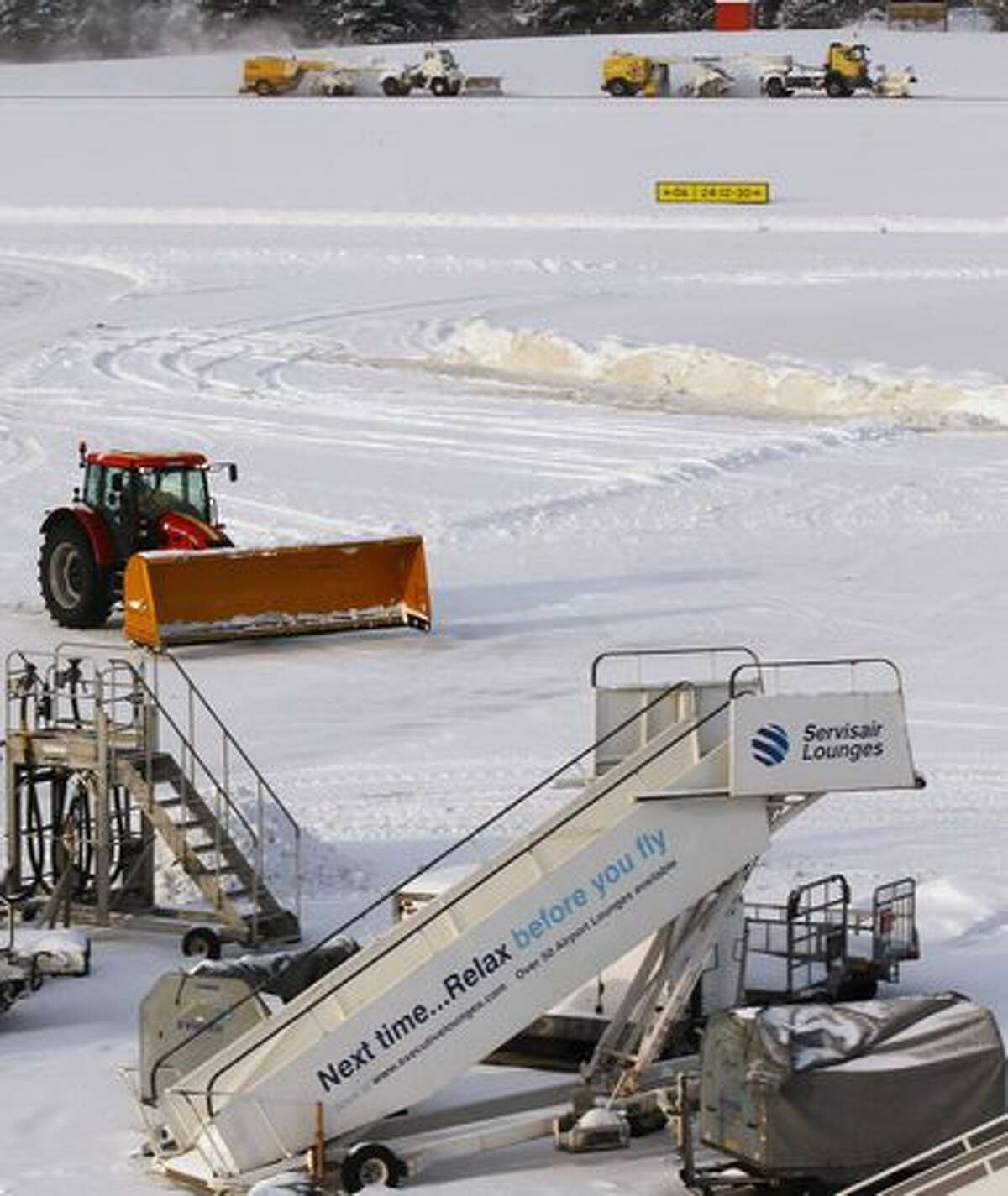 Crews attempt to clear snow from one of the runways at Edinburgh Airport, in Edinburgh, Scotland. Freezing weather conditions and heavy snow have forced Scotland's main airport to close for the day.