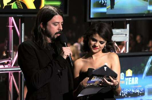Musician Dave Navarro (L) and actress Selena Gomez speak onstage. Photo: Getty Images